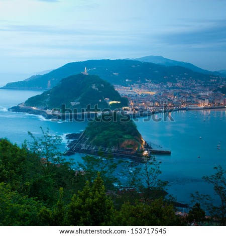 View over La Concha Beach from Monte Igeldo, San Sebastian, Spain at Night - stock photo