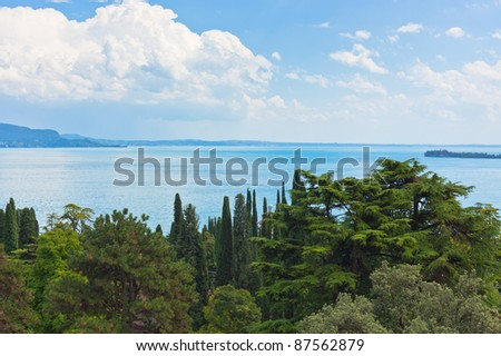 View Over Lake Garda in Italy from forest coast - stock photo