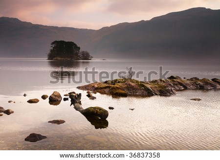 View over Loch Lomond to an island - stock photo