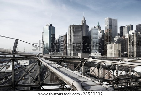 View over Manhattan, New York with Brooklyn bridge sections, rough industrial toning - stock photo