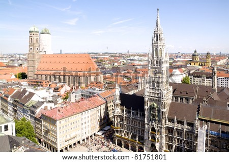 View over Munich's central Place Marienplatz with neo-gothic City Hall and Cathedral Frauenkirche - stock photo