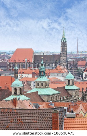 View over Nuremberg old town from the Kaiserburg, Franconia, Bavaria, Germany, with the spires of the Town Hall or Rathaus and St Lawrence church or Lorenzkirche.