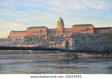View over river Danube to the Royal castle and Chain bridge in Budapest, Hungary on the early morning - stock photo