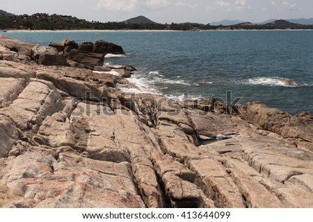 View over rocks to the blue ocean