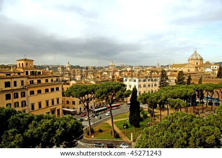 View over Rome from piazza Venezia with Vatican on the background under threatening clouds - stock photo