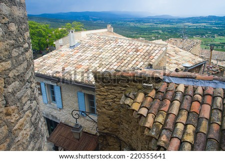View over roofs from Gordes to the country, Provence, France - stock photo