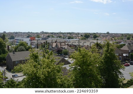 View over rooftops towards sea at Worthing. West Sussex. England. From tower of Saint Marys Church in Broadwater - stock photo