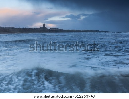 View Over Rough Sea To Tynemouth Church North Tyneside EnglandUK At