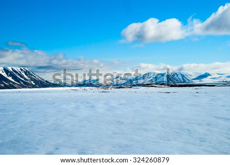 View over snowy mountains in Svalbard, Arctic, Norway - stock photo