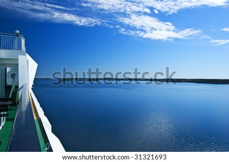 View over swedish archipelago with cruise ship detail - stock photo