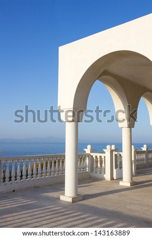 View over the Aegean Sea from the porch or terrace with arches and columns of orthodox church Profitis Ilias in Keratea, near Lavrio, in East Attika, Greece.