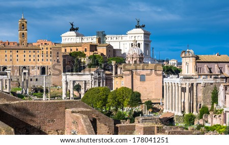 View over the ancient Forum of Rome showing temples, pillars, the senate and the Vittorio Emanuelle monument. - stock photo
