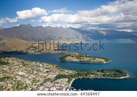 View over the city and mountains - stock photo