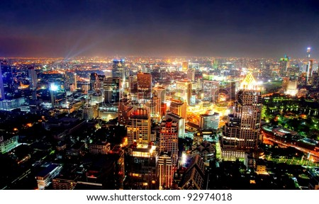 View over the city of bangkok at nighttime with skyscrapers - stock photo