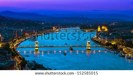 View over the Danube river and her bridges and Parliament from Gellert Hill at sunset. Budapest, Hungary - stock photo