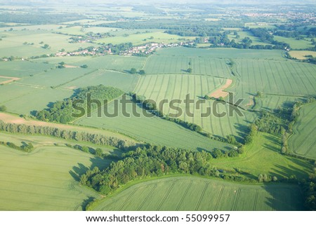 view over the early summer green fields from hot air balloon; East Anglia; UK