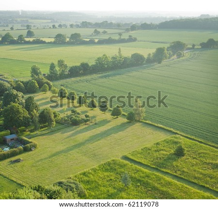 view over the early summer green fields from the air; East Anglia; UK; - stock photo
