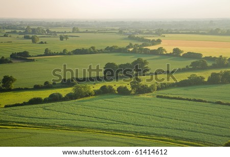 view over the early summer green fields from the air; East Anglia; UK; England - stock photo