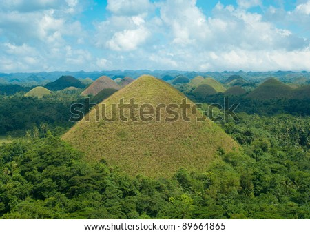 view over the famous chocolate hills on Bohol, Philippines. They are also featured in the provincial flag