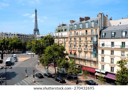 View over the grand streets of Paris, France with Eiffel Tower - stock photo