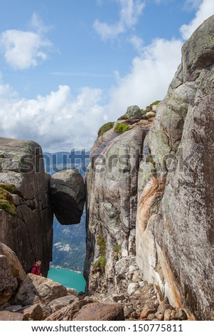 View over the Kjerag Bolt rock with Lysefjorden nine hundred meters below - stock photo