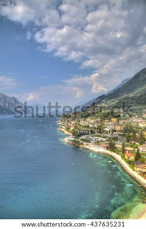 view over the Lake Garda with the charming village Malcesine at the east bank with dramatic cloudy sky