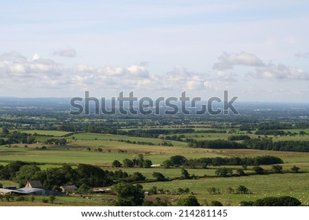 View over the Lancashire countryside towards Preston from Parlick Pike, one of the Bleasedale Fells in the picturesque Forest of Bowland. - stock photo