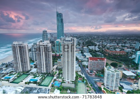 view over the modern city at twilight with ocean beside (gold coast,qld,australia) - stock photo