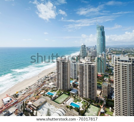 view over the modern city during the day with ocean beside - stock photo