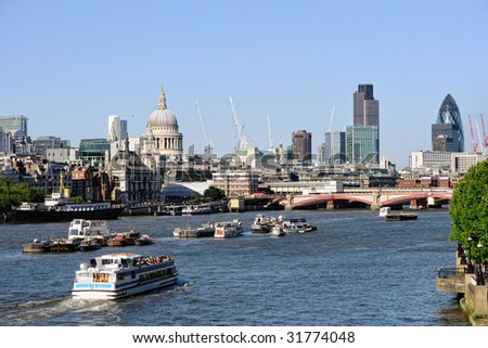 View over the River Thames, London, England, UK to St Paul's Cathedral in the late afternoon - stock photo