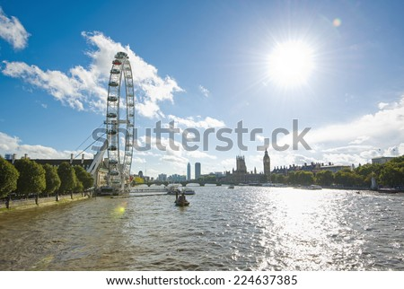 View over the river Thames with London Eye, Westminster Bridge, Elizabeth Tower (Big Ben Clock Tower) and Houses of Parliament, London, United Kingdom, Europe - stock photo