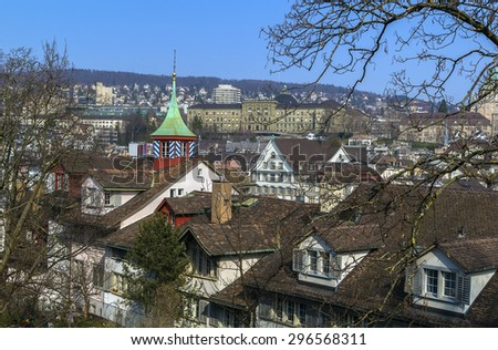view over the rooftops of historic buildings with small tower in Zurich, Switzerland - stock photo
