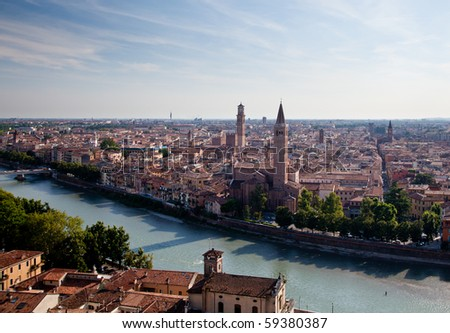 View over the rooftops of Verona, Italy as the sun is setting in the evening - stock photo