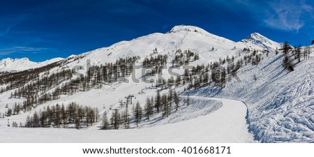 View over the snow-clad slopes of Sestriere in the Milky Way ski resort in Piedmont. - stock photo