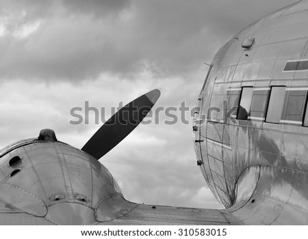 view over the wing of a historic airplane, black and white - stock photo