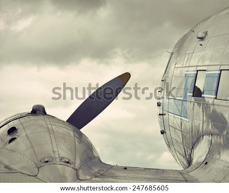 view over the wing of a historic airplane, vintage style - stock photo