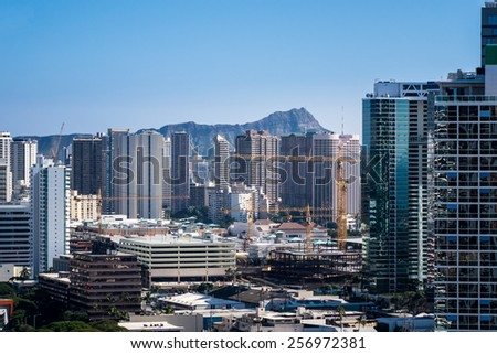 View over Waikiki showing new condos under construction as the city of Honolulu expands on Oahu, Hawaii - stock photo