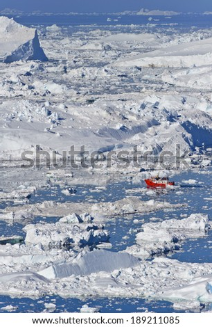 View overlooking the icefjord of the Jakobshavn glacier, outside Illulisat, Greenland. These icebergs are calved by the Jakobshavn glacier. - stock photo