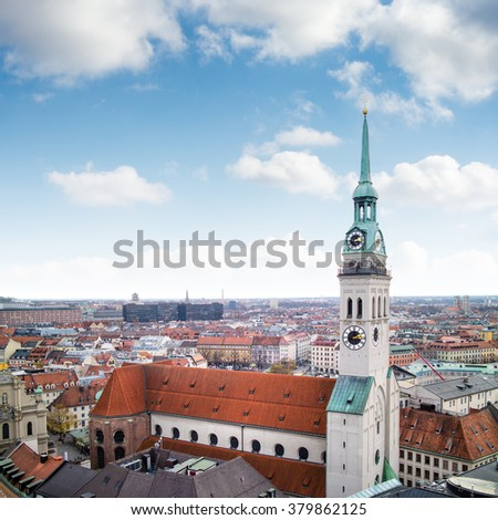 View overlooking the town of Munich with a tower of the famous St. Peter's Church in the foreground. - stock photo