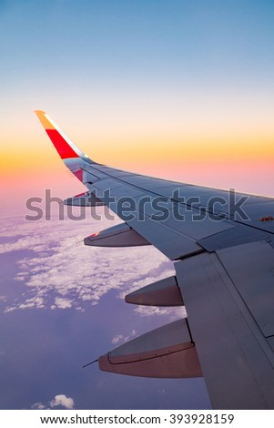 View plane wing from Airplane Window  - stock photo