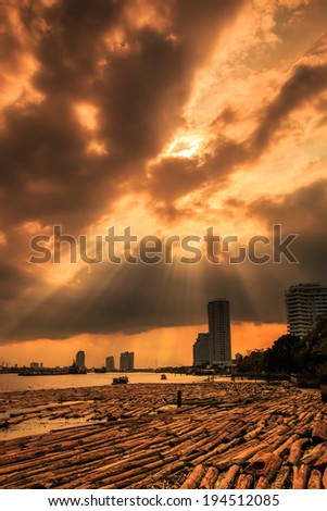 View sunset landscape at Pile of wood be immersed in water at the Bangkok Asia Thailand