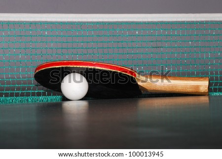 view table tennis racket with a large ball and net - stock photo