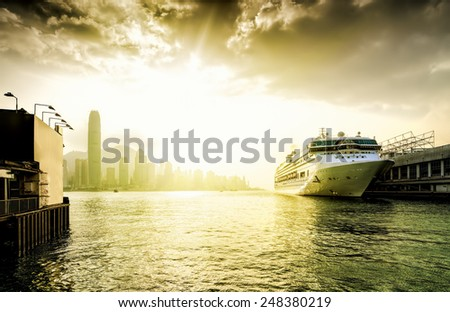 View the city at night from Kowloon promenade. Hong Kong. China. Golden Sunset. - stock photo