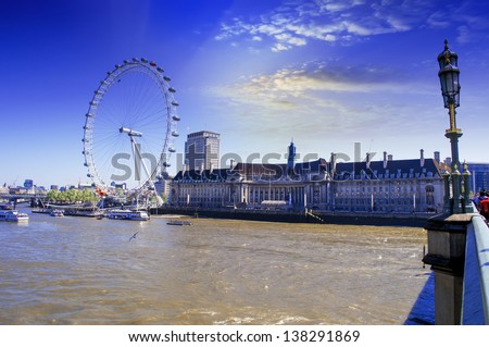 View the London Aquarium and the London Eye from Westminster Bridge. - stock photo