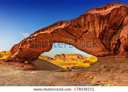 View through a rock arch in the desert of Wadi Rum, Jordan, Middle East - stock photo