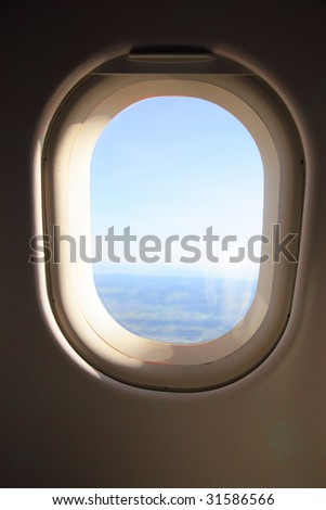 View through an airplane window - stock photo