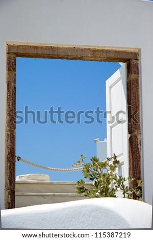 View through an old window in Santorini island, Greece - stock photo