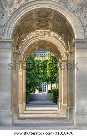 View through Arc de Triomphe du Carrousel, a triumphal arch in Paris, France - stock photo