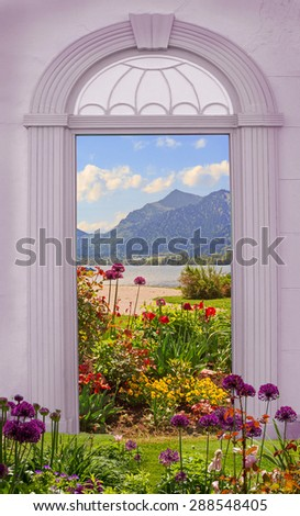 view through arched door, idyllic lake shore with flowerbed - stock photo