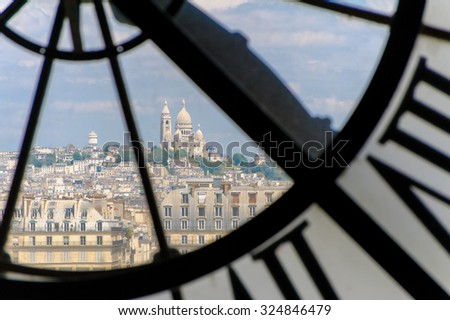 View through d'orsay clock tower in Paris, France - stock photo